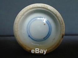 A Chinese porcelain pos. Kangxi u/g blue small Vase, 13.5cms. High, slight damage