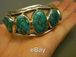High grade turquoise sterling silver bracelet 1 1/2 tall 107 gr signed C. CHAMA