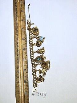Vintage Signed Monet Loaded Articulating Moving High Quality 8 Charms Bracelet